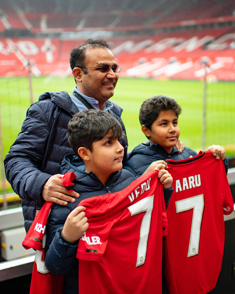 Virender Sehwag and his sons at Manchester United stadium | Getty