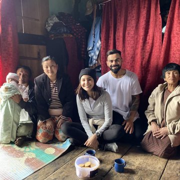 Virat and Anushka with a family in Bhutan | Twitter