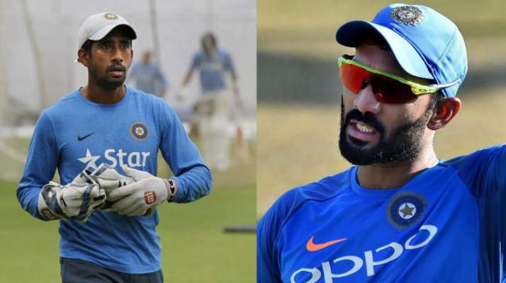 With Saha's fitness in doubt, team management is mulling keeping Dinesh Karthik back for the Tests