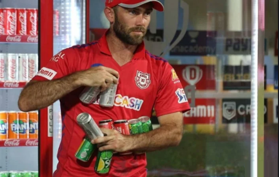 Glenn Maxwell is seen carrying a lot of soft drinks | ESPNCricinfo