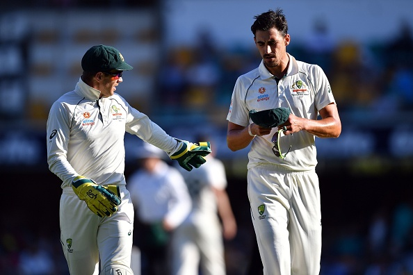 Tim Paine and Mitchell Starc | Getty Images