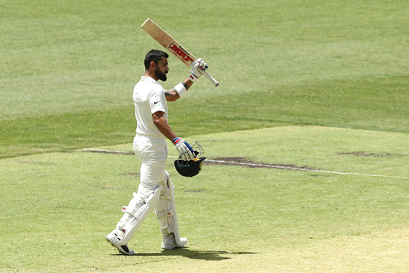 Virat Kohli raises bat to celebrate his 25th century | Getty