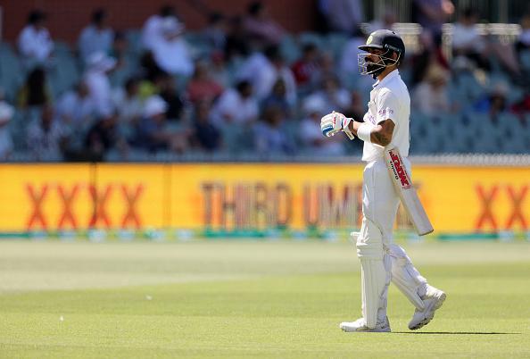 A dejected Virat Kohli walks off | Getty