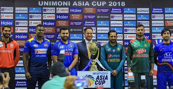 Captains of Hong Kong, Sri Lanka, India, Pakistan, Bangladesh and Afghanistan posing with the Asia Cup trophy | Getty