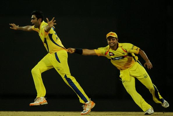 R Ashwin and Suresh Raina celebrating Chris Gayle's wicket | GETTY