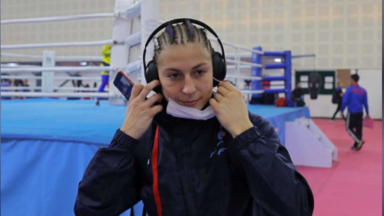France's Mona Mestiaen removes a mask after her practice session ahead of AIBA Women's World Boxing Championships | Reuters