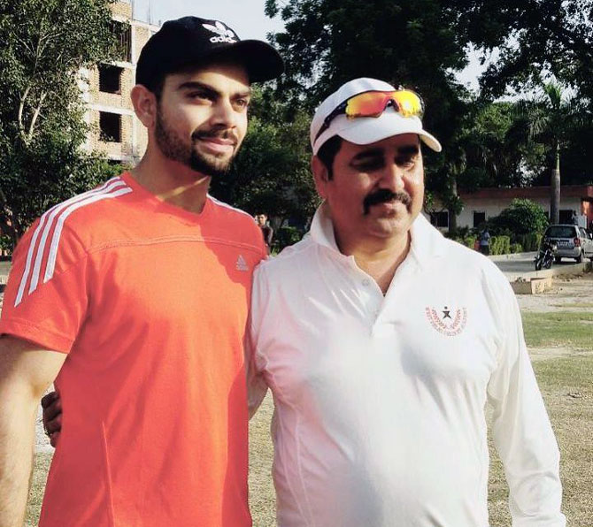 Virat Kohli with his childhood coach Rajkumar Sharma | Rediff