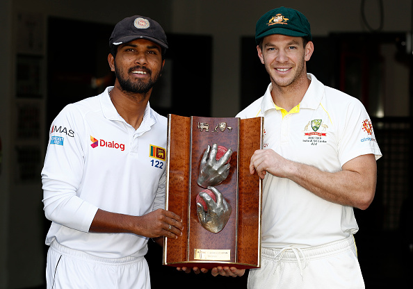 Dinesh Chandimal and Tim Paine poses with the Warne Muralitharan Trophy at The Gabba | Getty Images