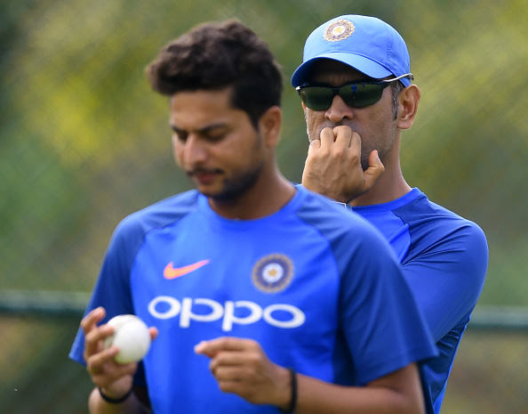 Kuldeep Yadav and MS Dhoni | Getty