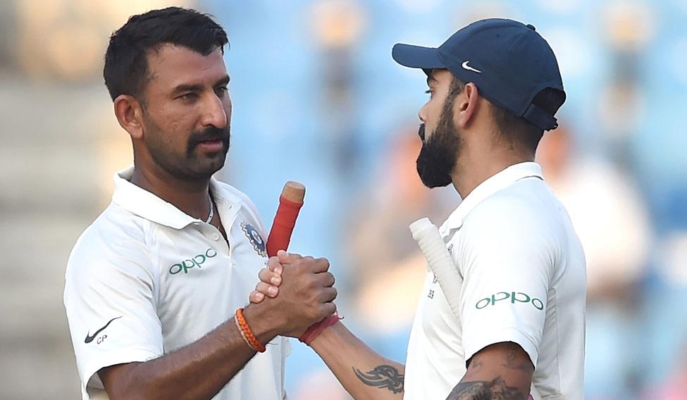 Cheteshwar Pujara and Virat Kohli | AFP