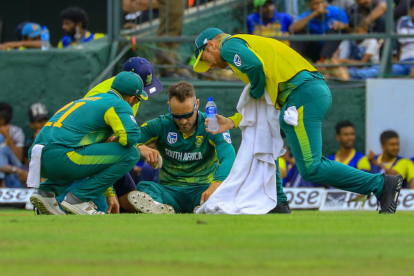 Faf Du Plessis receives medical assistance after diving for a catch during the 3rd ODI against Sri Lanka | Getty