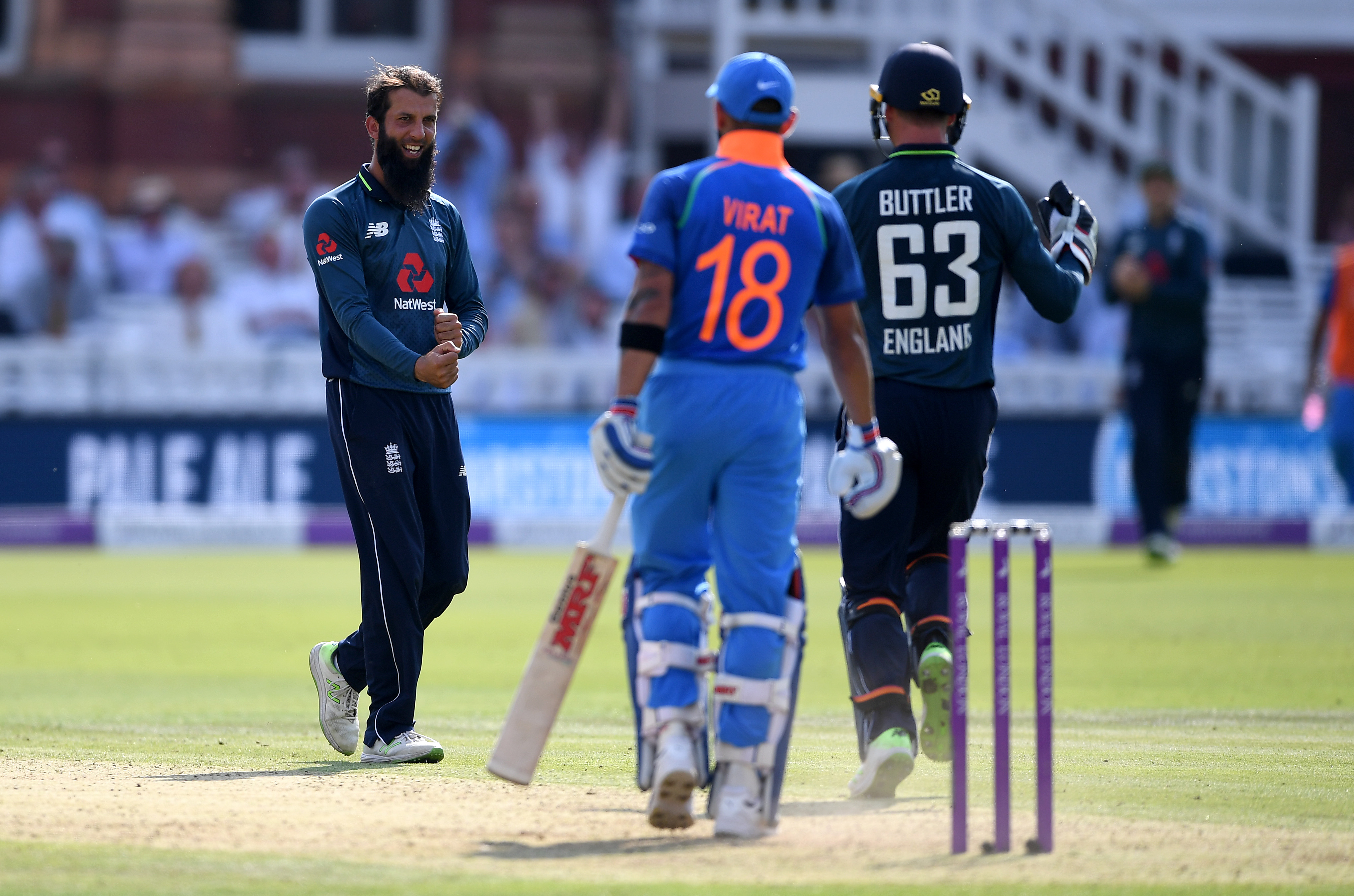 Moeen Ali celebrates dismissing India captain Virat Kohli at Lord's | Getty