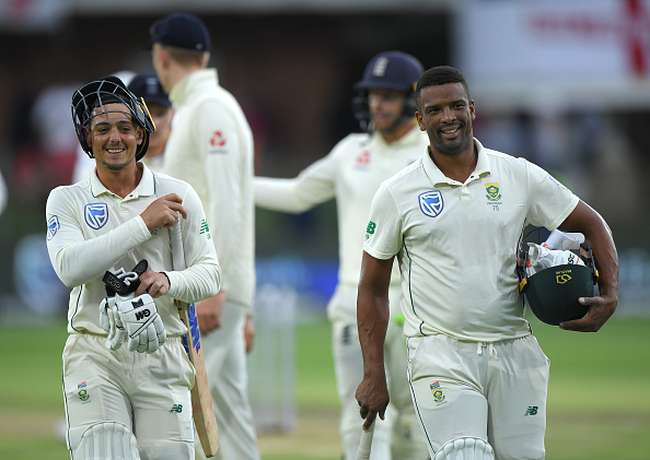 Quinton de Kock and Vernon Philander leave the field after the end of third day's play | Getty