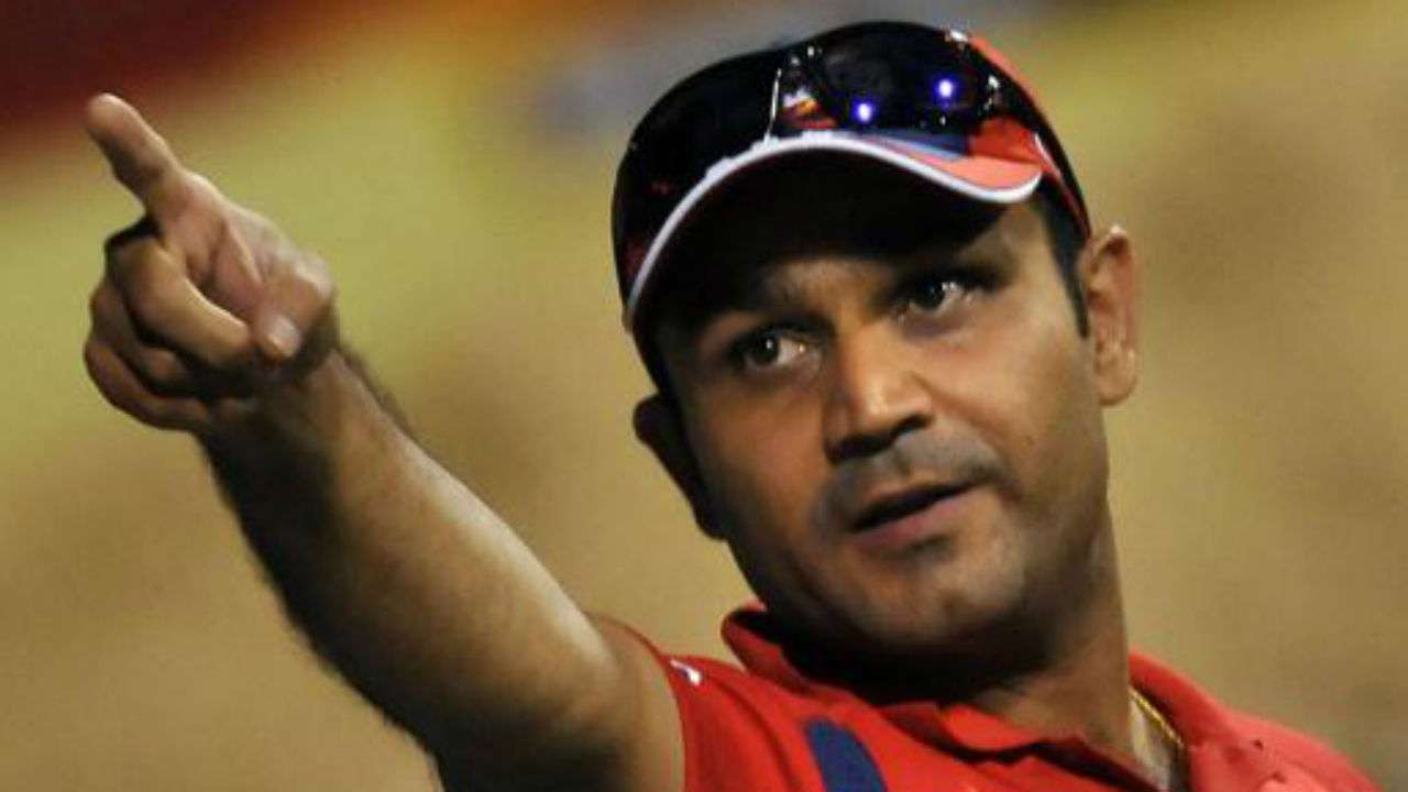 Virender Sehwag was playing a friendly match when a fan came into the ground to touch his feet