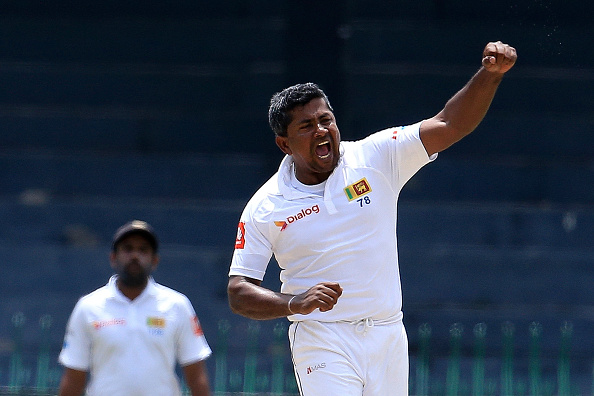 Sachin Tendulkar and Suresh Raina congratulates Rangana Herath on his achievement