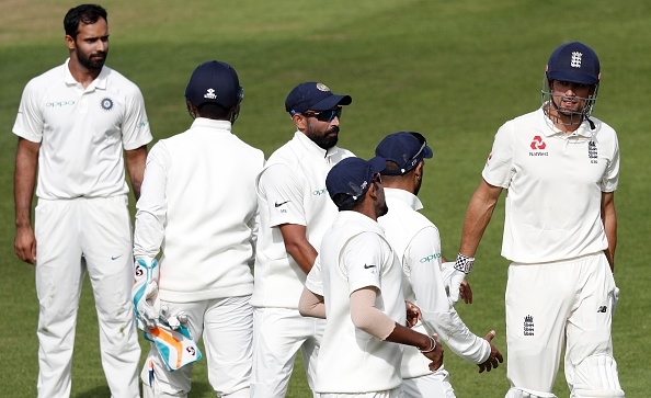 Indian players shake hands with Alastair Cook as he leaves the field after his dismissal for 147 | Getty