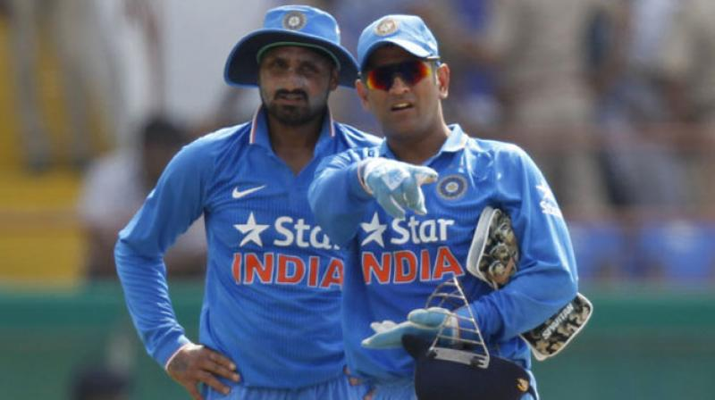 Harbhajan Singh and MS Dhoni | AFP