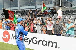 Bahir Shah of Afg U19 celebrates their QF win of NZ U19 with Afghan supporters | Getty