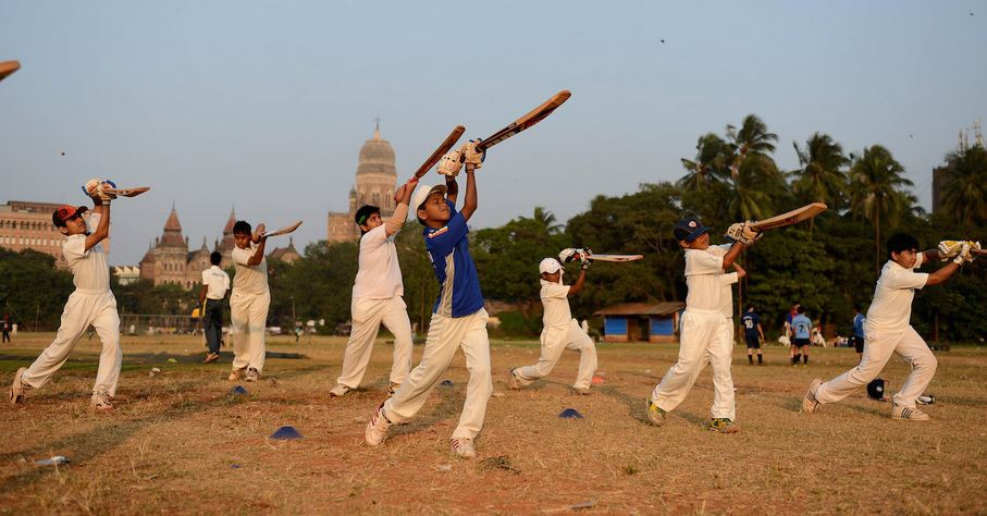 Budding cricketers practicing their shots in a ground in Mumbai | Getty