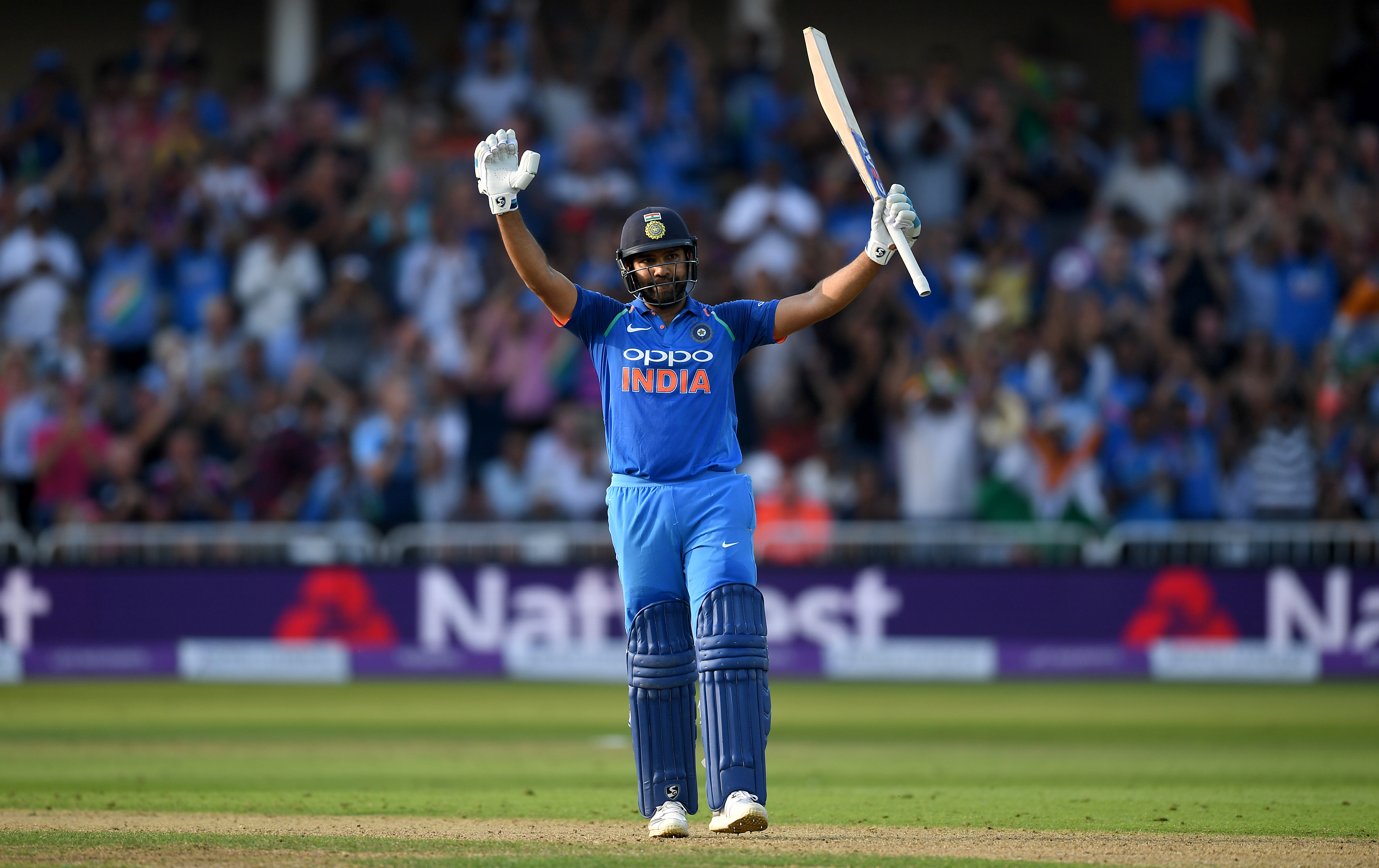 Rohit Sharma celebrates reaching his century in the first ODI against England at Trent Bridge | Getty