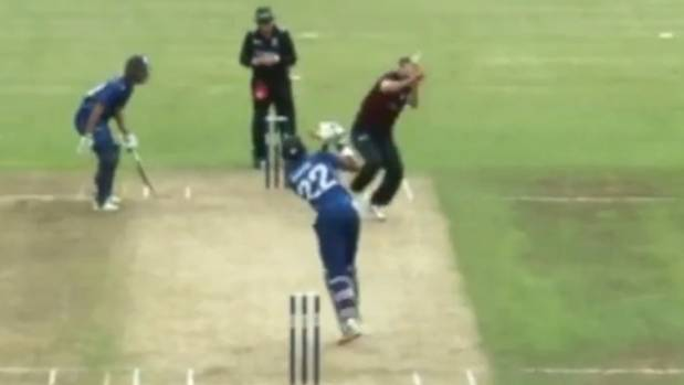 Andrew Ellis is hit on the head with the ball when bowling to Auckland batsman Jeet Raval | Twitter