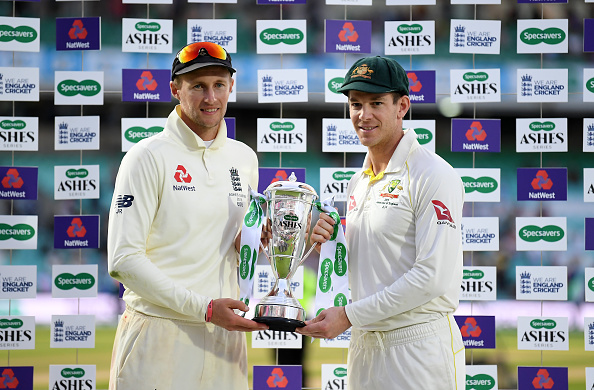 Joe Root (L) and Tim Paine (R) with the trophy | Getty Images