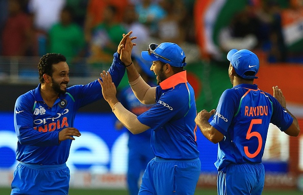 Rohit Sharma and Kedar Jadhav celebrating a wicket | GETTY