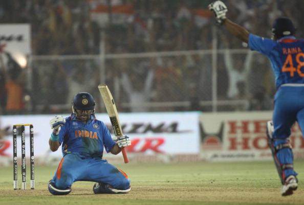 Yuvraj Singh and Suresh Raina celebrate after hitting the winning runs | Getty