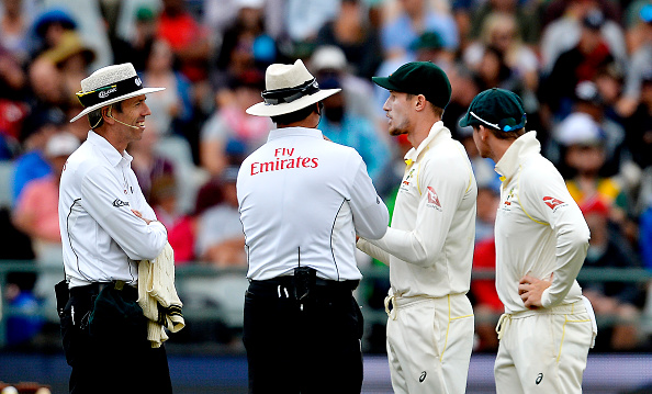 Umpires chatting with Bancroft after he tried to alter the condition of the ball during the Cape Town Test earlier this year | Getty