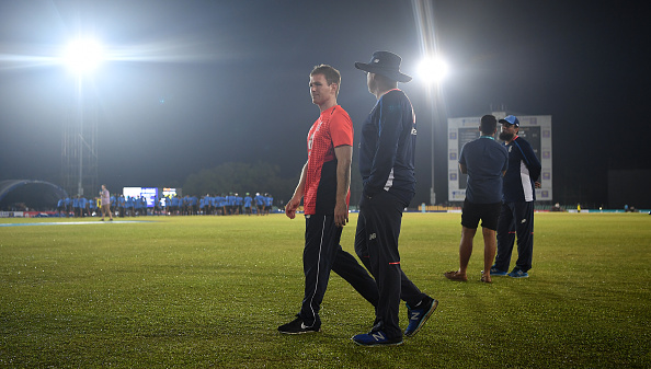 Eoin Morgan and Trevor Bayliss inspects the wet outfield in Dambulla | Getty Images