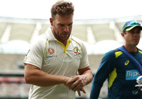 Aaron Finch leaves the ground after being struck on the finger in Perth | Getty