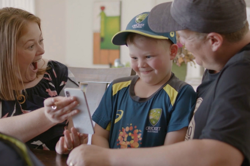 Archie Schiller with his parents during a call with Langer | Cricket Australia Twitter