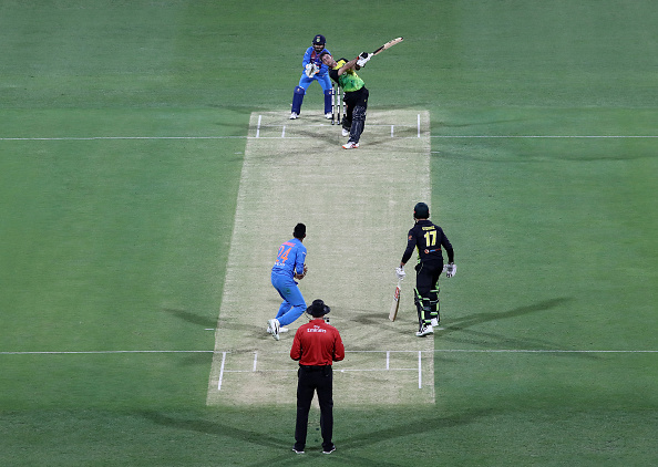 Glenn Maxwell plays a shot in the air that hit the spider camera during the first T20I in Brisbane | Getty