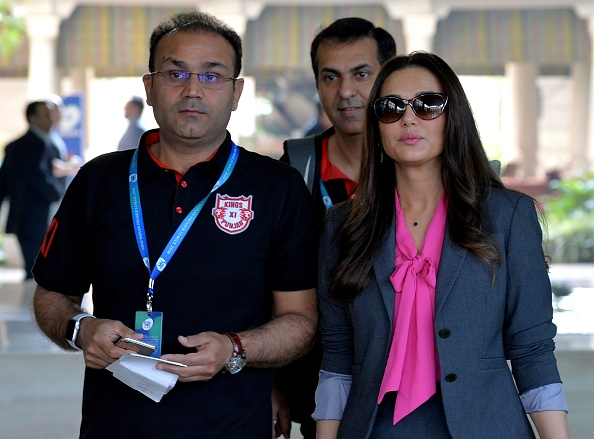 Virender Sehwag with Kings XI Punjab co-owner Preity Zinta | Getty Images