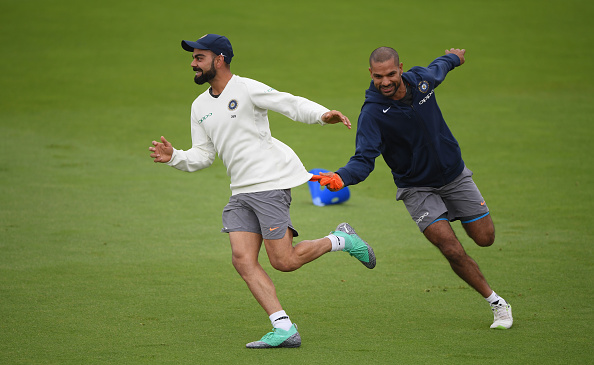 Virat Kohli and Shikhar Dhawan | Stu Forster/Getty Images