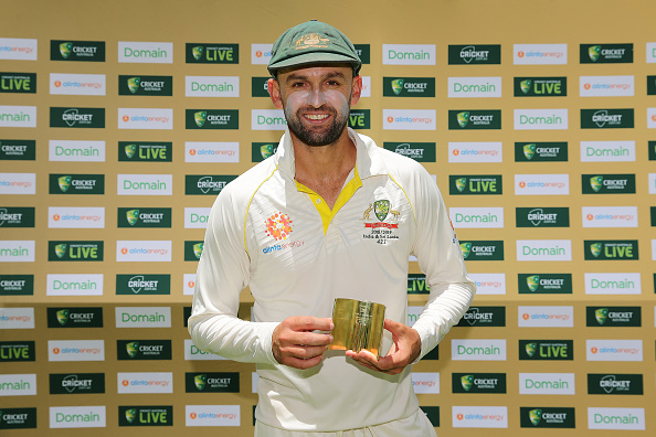 Nathan Lyon of Australia poses with the Player of the Match award | Getty