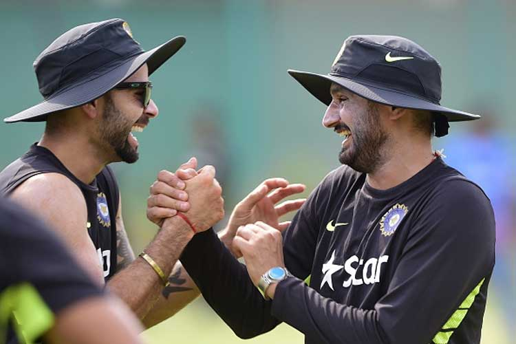 Virat Kohli with Harbhajan Singh | GETTY