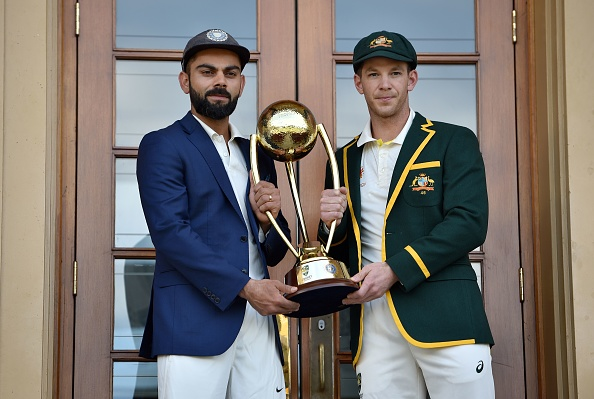 Tim Paine and Virat Kohli pose with the Border-Gavaskar Trophy | Getty
