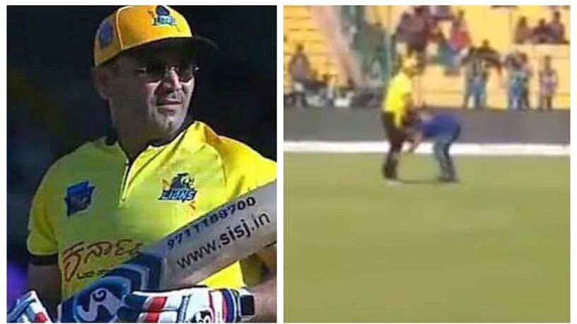 WATCH- Virender Sehwag's fan jumps the barrier to enter the ground and touches his feet