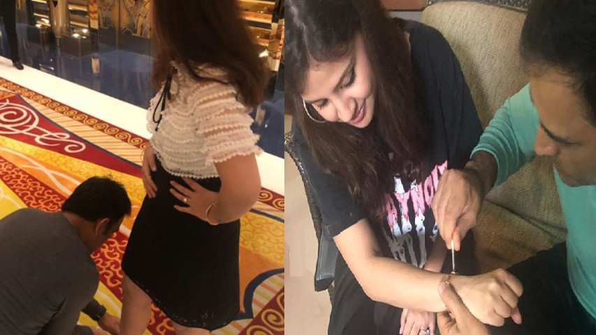After shoes, MS Dhoni helps Sakshi screw a band on her wrist