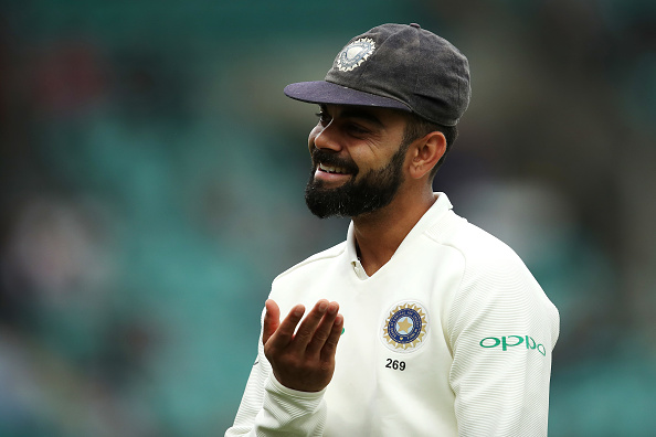 Virat Kohli smiles as umpires call the day off due to bad light | Getty