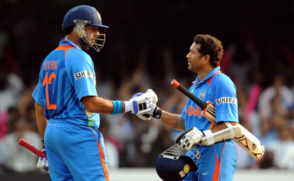 Yuvraj Singh and Sachin Tendulkar in action during World Cup 2011 | Getty