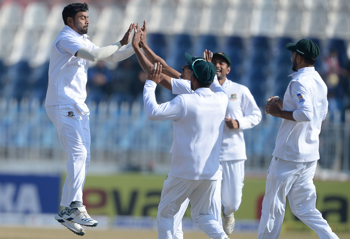 Abu Jayed celebrates a wicket with teammates | AFP