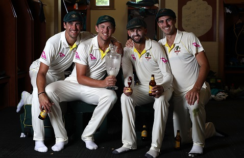 Australia's bowling quartet – Mitchell Starc, Josh Hazlewood, Nathan Lyon and Pat Cummins with Ashes Trophy | Getty Images
