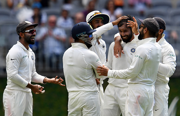 Hanuma Vihari celebrates the dismissal of Australia batsman Marcus Harris with his teammates | Getty