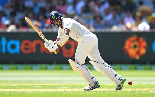 Pujara scored a patient 106 off 319 balls in India's first innings at MCG | Getty