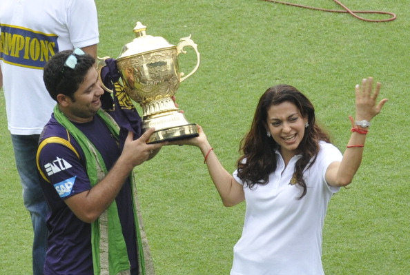 Piyush Chawla and KKR co-owner Juhi Chawla holding the IPL trophy | Getty