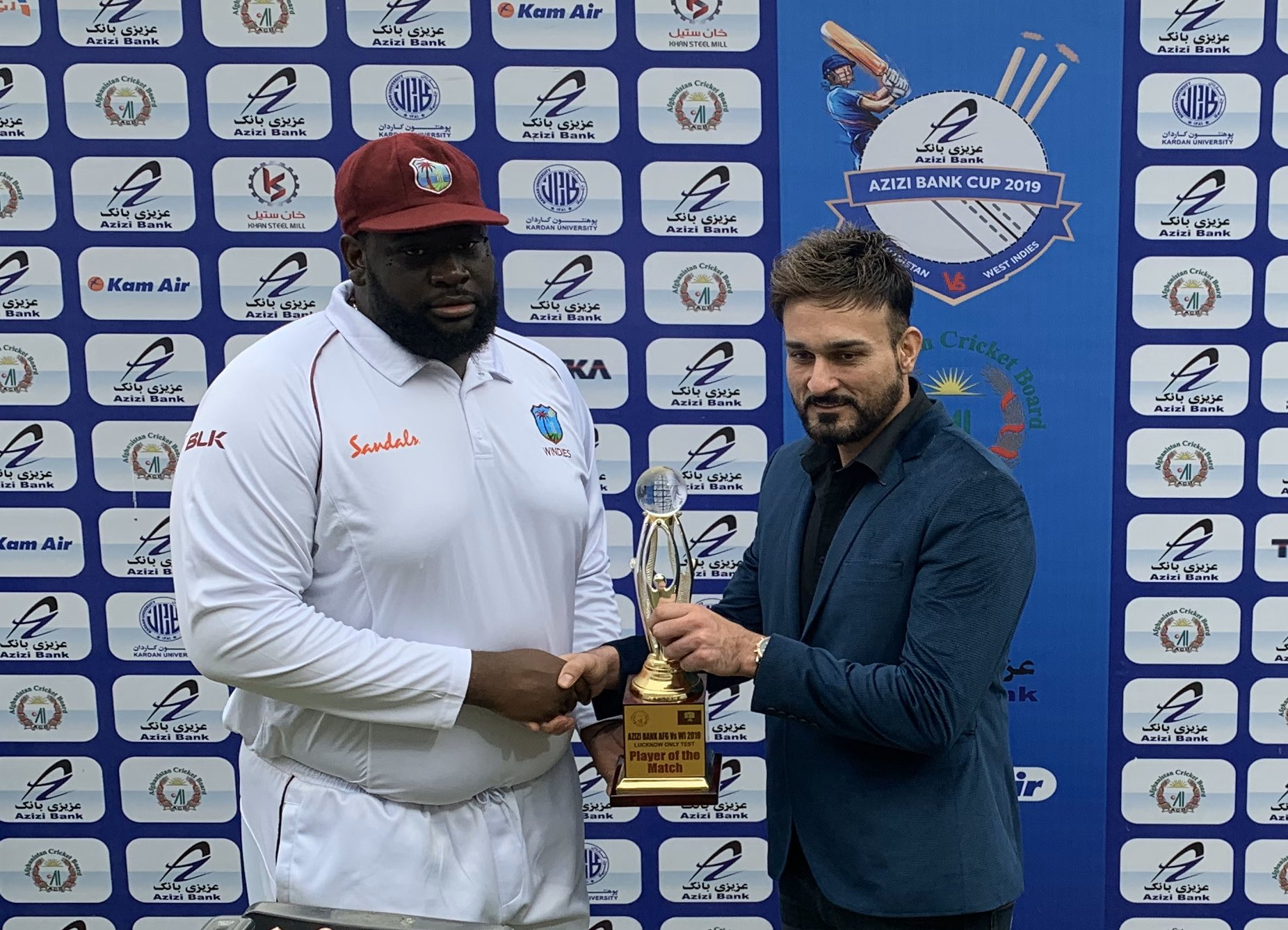 Rahkeem Cornwall receiving his Man of the Match trophy for picking 10 wickets in the match | Twitter