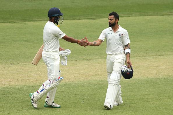 Cheteshwar Pujara and Virat Kohli   CA/Cricket Australia/Getty Images