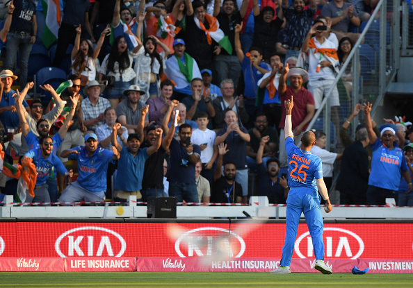 Shikhar Dhawan celebrates to the crowd after catching Eoin Morgan in Cardiff | Getty